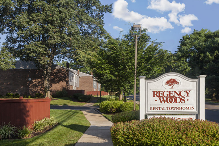 Entrance sign to Regency Woods apartments in Doylestown, PA